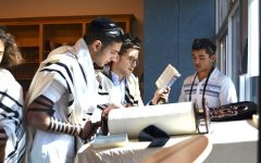 Senior Jeremy Ashagian chanted from the Torah scroll as Rabbi David Block followed along watching for errors. Many students know how to do this, and a few do it professionally on a regular basis at synagogues like B'nai David-Judea and Young Israel of North Beverly Hills.