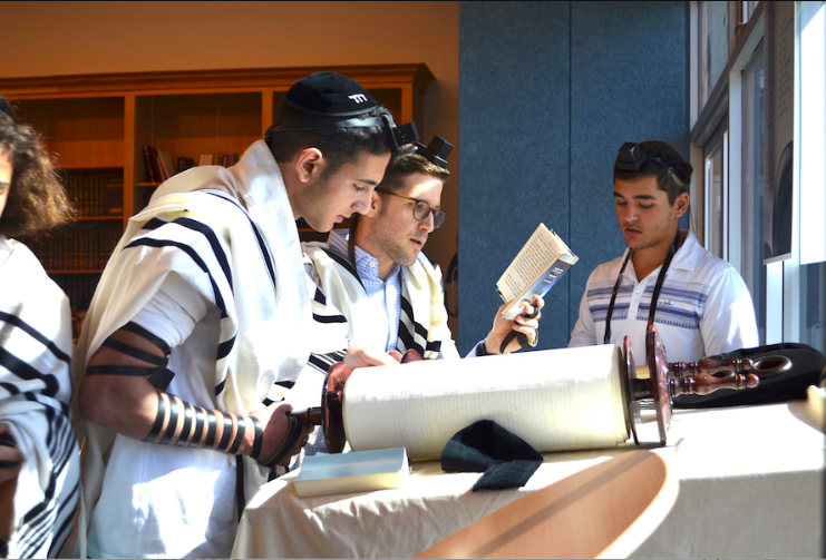 CHANT: Shalhevet High School senior Jeremy Ashagian chanted from the Torah scroll as Rabbi David Block followed along watching for errors. Many students know how to do this, and a few do it professionally on a regular basis at synagogues like B'nai David-Judea and Young Israel of North Beverly Hills.